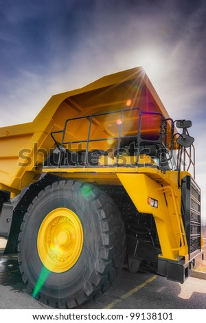 Large haul truck with controled flare and dark blue sky. - stock photo