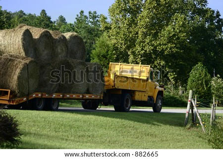 Large hayrolls being transported