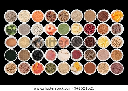 Large health and body building high protein super food with high nutritional values including meat, fish, dairy, pulses, cereals, grains, seeds, supplement powders, fruit and vegetables. - stock photo