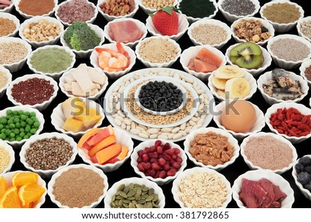 Large health and body building protein super food with high nutritional values including meat, fish, dairy, pulses, cereals, grains, seeds, supplement powders, fruit and vegetables. Selective focus. - stock photo