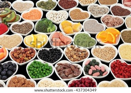 Large health and body building protein super food with high nutritional values including meat, fish, pulses, cereals, grains, seeds, supplement powders, fruit and vegetables. - stock photo