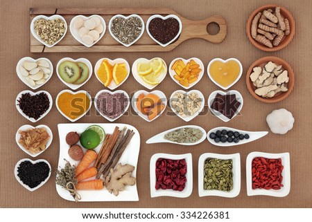 Large health food selection for cold cure remedy with vitamin c supplement capsules and medicinal herbs and spices, high in antioxidants. - stock photo