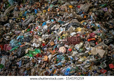 Large heap of garbage inside a processing plant - stock photo