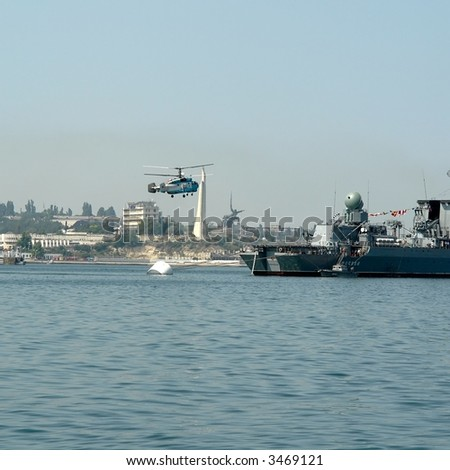 Large helicopter lands aboard the warship - stock photo