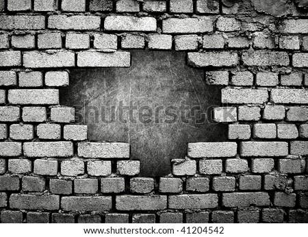 large hole on brick wall - stock photo