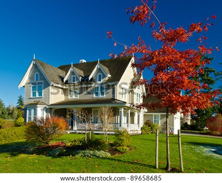 Large home in autumn - stock photo