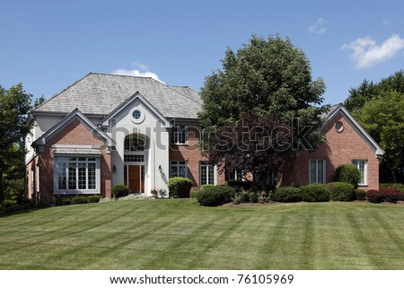 Large home in suburbs with arched entry - stock photo