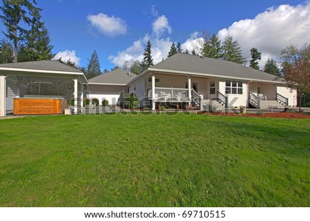 Large home with porches and hot tub - stock photo