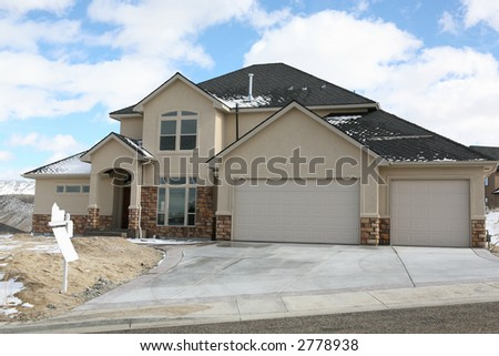 Large house with blank real estate for sale sign - stock photo
