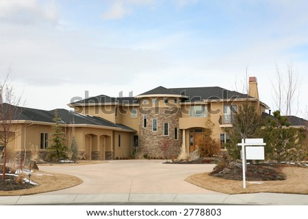 Large house with for sale sign - stock photo