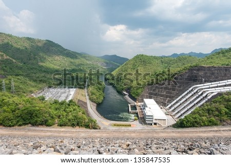 Large hydro electric dam in Thailand, taken on a cloudy day - stock photo