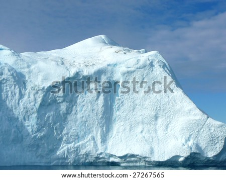 Large iceberg in the sunshine, Greenland coast - stock photo