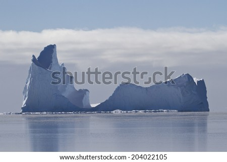 large iceberg with a single vertex in the waters of the Southern Ocean - stock photo