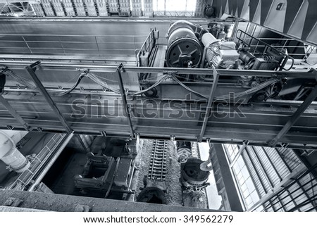 Large industrial crane equipment scene in steel mill - stock photo