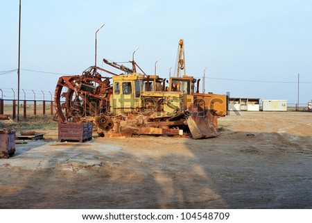 Large industrial excavators parked at the side of a road on a construction site or roadworks