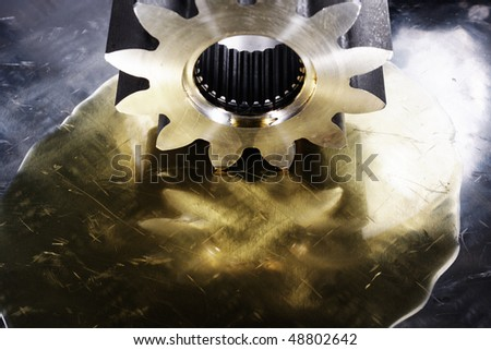 large industrial gear drenched in lubricant oil - stock photo