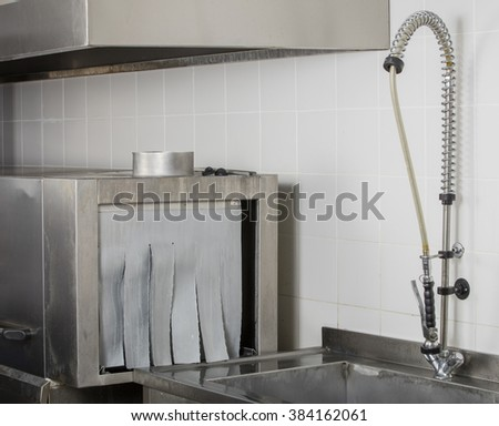 large industrial kitchen dishwasher and sink all stainless steel - stock photo