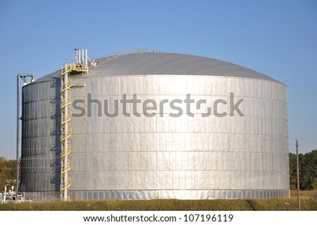 large industrial natural gas or propane holding tank - stock photo