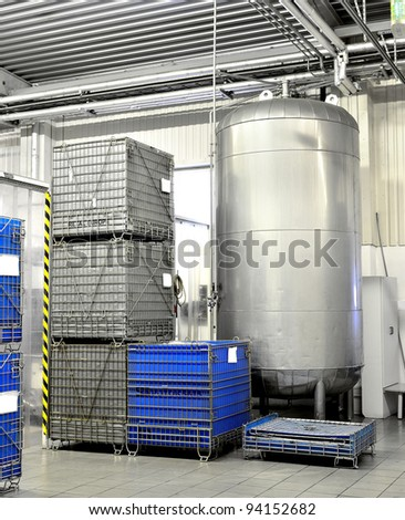 Large industrial tank and chemical containers at the clean warehouse - stock photo