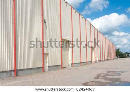 large industrial warehouse covered with lots of orange drainpipes