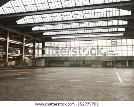 Large Interior grunge framed warehouse with an empty floor . - stock photo