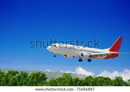 Large jet passenger airplane approaching for landing - stock photo