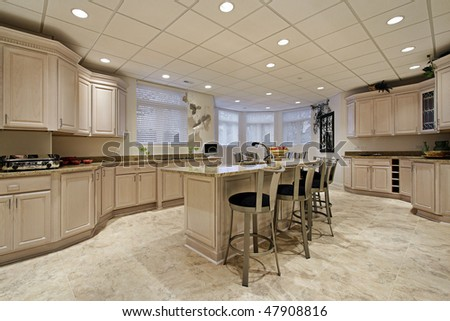 Large kitchen in lower level of luxury home - stock photo