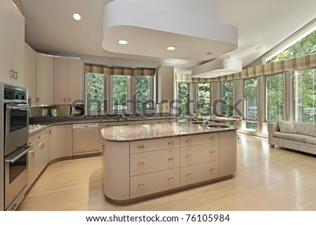 Large kitchen in luxury home with center island - stock photo