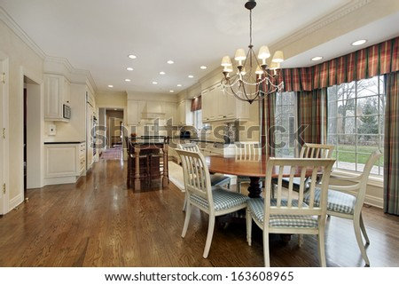 Large kitchen in suburban home with eating area - stock photo
