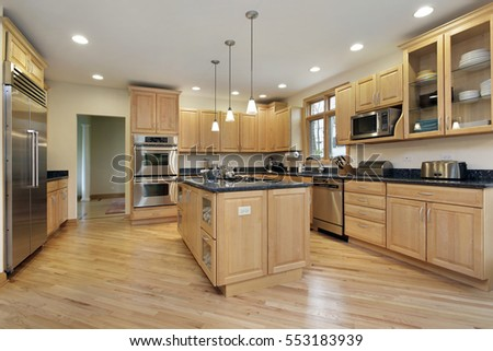 Large kitchen in upscale home with oak wood cabinetry.
