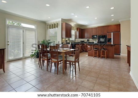 Large kitchen with redwood cabinetry and eating area - stock photo