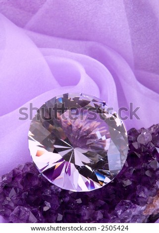 Large leaded crystal cut as a diamond on lavender amethyst stone with lavender background. - stock photo