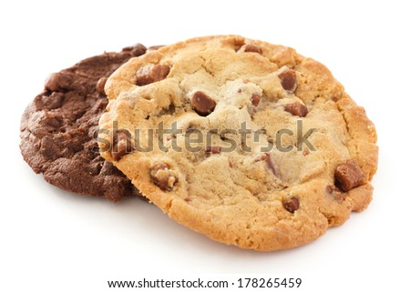 Large light chocolate chip cookie on a white surface - stock photo