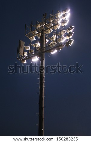 Large lights over sports complex - stock photo