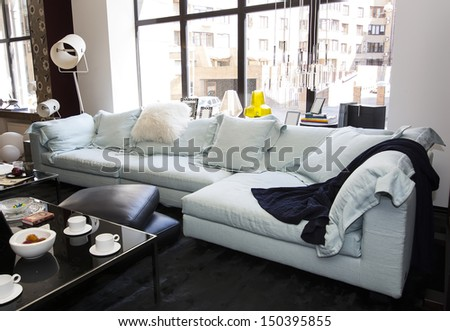 large living room with comfortable sofas and furniture - stock photo