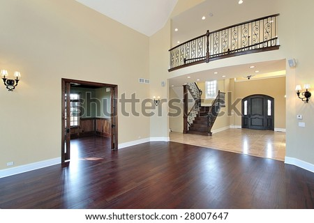 Large living room with view of balcony and foyer - stock photo