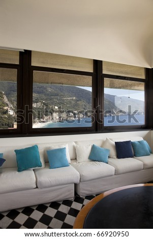 large living-room with white sofa and panoramic view - stock photo