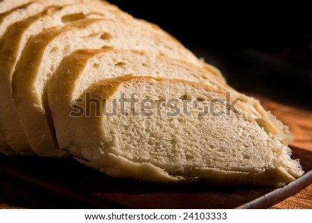 Large Loaf of sourdough bread resting on Acacia bread board