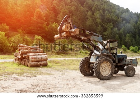 Large log loader and operations - stock photo