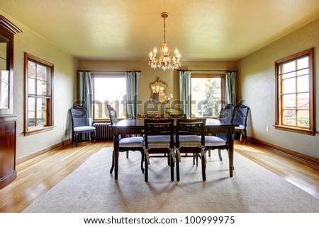 Large luxury elegant old dining room with four windows. - stock photo
