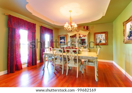 Large luxury green dining room with cherry hardwood. - stock photo