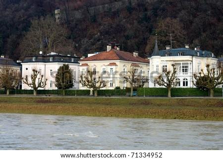 Large luxury homes beside the Salzach River, Salzburg, Austria - stock photo