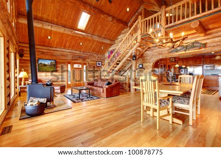 Large luxury log house living room with staircase. - stock photo