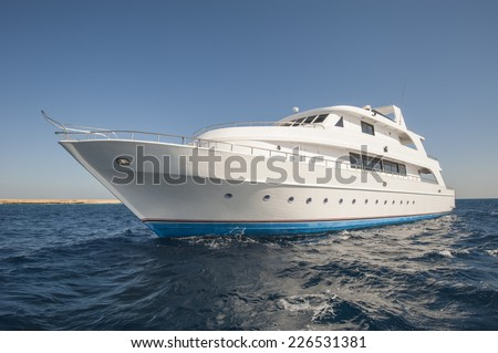 Large luxury motor yacht on a tropical sea - stock photo