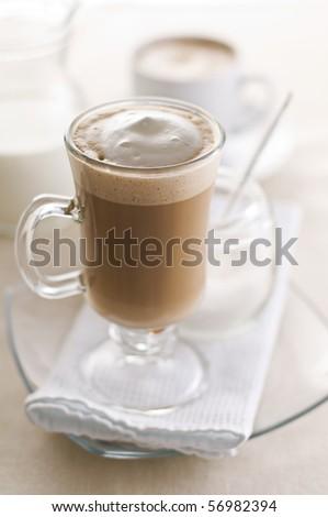Large macchiato with cream and sugar close up - stock photo