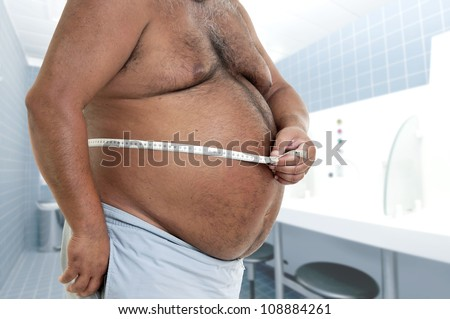 Large man belly with measuring tape - stock photo