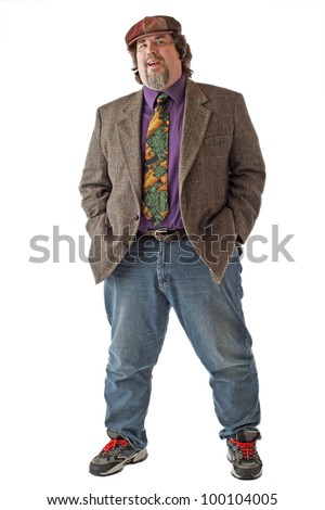 Large man in tweed cap and jacket smiles and stands with legs apart and both hands in pockets. Isolated on white background, vertical, copy space. - stock photo