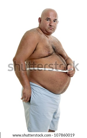 Large man with big belly and measuring tape - stock photo