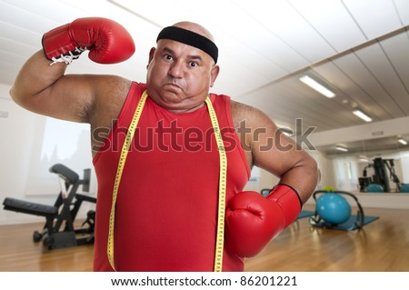 Large man with boxing gloves - stock photo