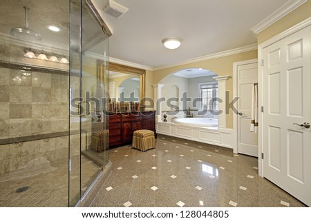 Large master bath with arched bathtub area - stock photo